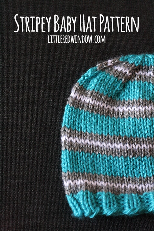 Closeup of Blue hat with gray and white stripes on a dark background