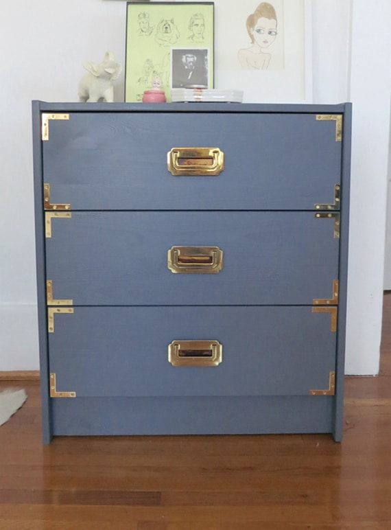 Slate blue campaign dresser with gold hardware
