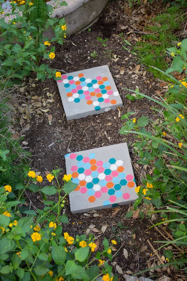 Concrete stepping stones with colorful hexagon pattern in a garden