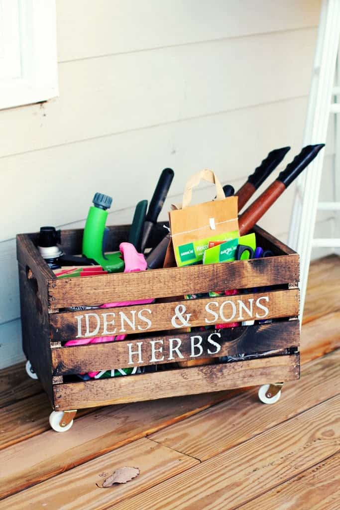 Wooden crate with wheels stamped with the words IDENS & SONS HERBS