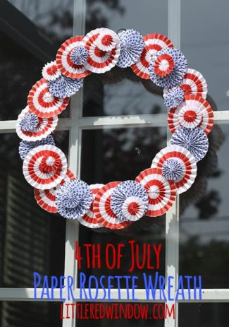 Red and white rosette wreath on a window