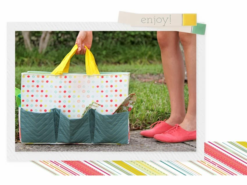 Person's feet and hand holding a handmade gardening tote with polka dot fabric