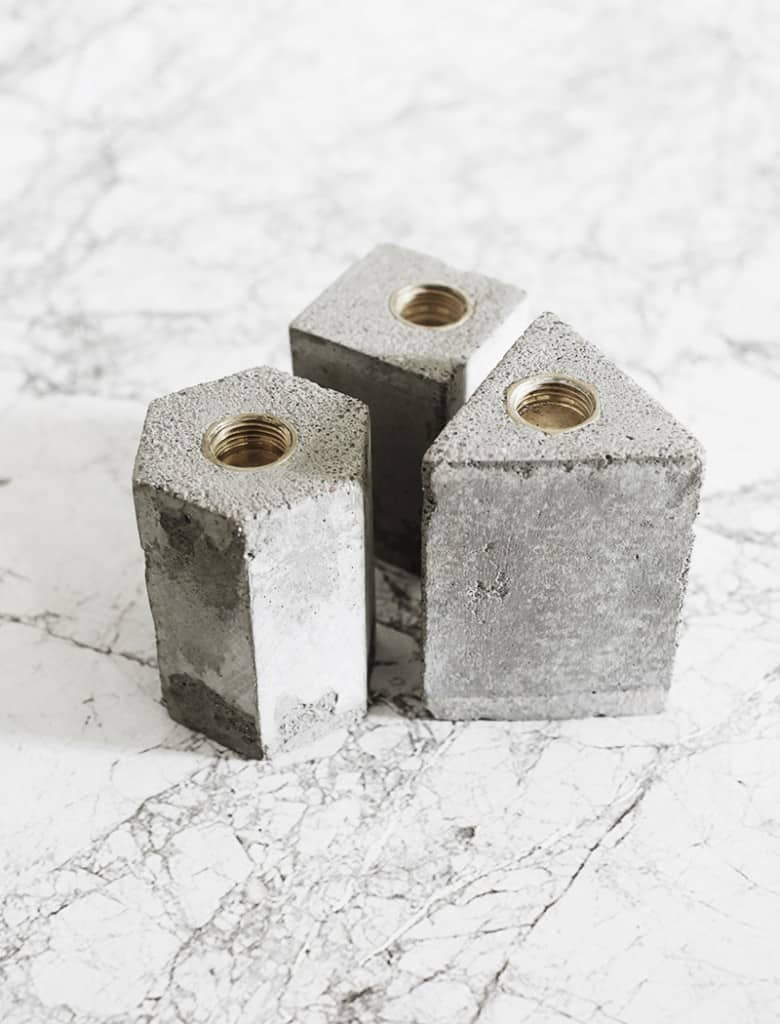 3 concrete candle holders