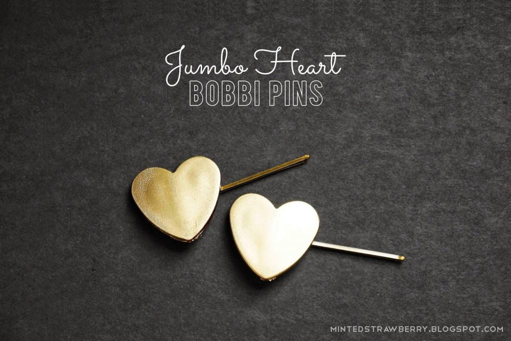 Bobby pins with gold leather hearts attached to one end