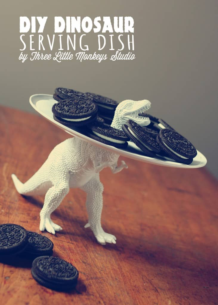 Serving dish held up by a white tyranosaurus rex, it's holding Oreos