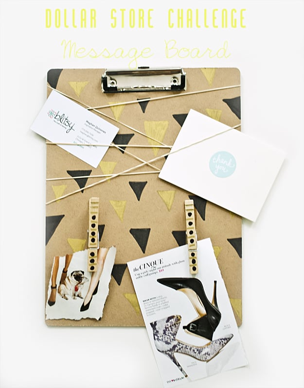 Clipboard with black and gold triangle pattern and rubber bands around it to hold cards and photos