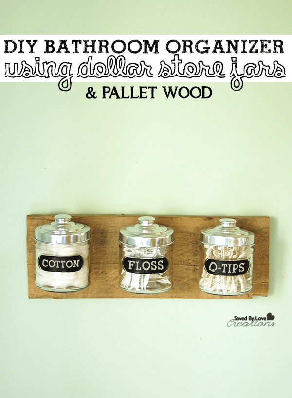 mind wall with wood wall hanging that holds three jars for cotton, floss and q-tips