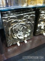 Metallic 3D flower wall hanging in a store