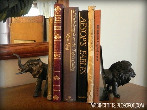 Bookends made from half a lion and elephant toy cut in half and painted black