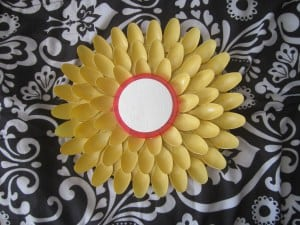 Starburst mirror made from yellow spoons