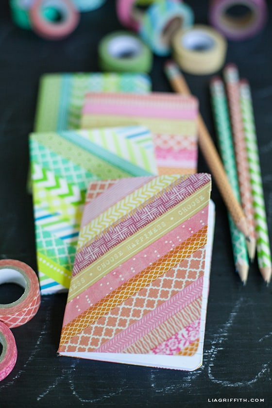 Little notebooks covered in diagonal stripes of washi tape