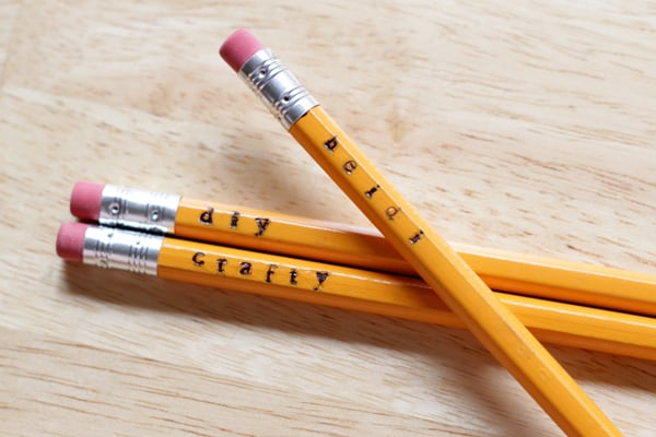 pencils with words and names stamped on them