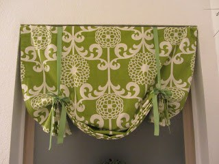 Green floral fabric shade with green ribbon ties holding it up