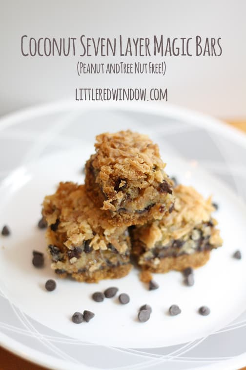 Nut Free Coconut Seven Layer Magic Bars on a white plate with chocolate chips