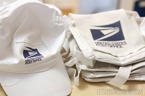 Pile of bags and caps with post office logo