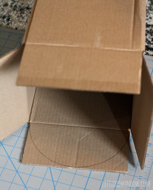 Box with a half circle drawn on one of the top flaps