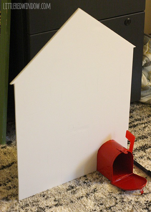Flat white house shape with a red mailbox in the lower corner