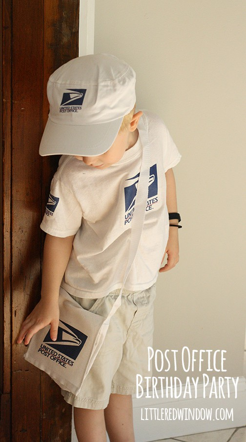 Little boy wearing Mail Carrier costume