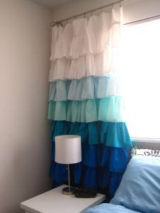 Ruffled curtains with blue ombre coloring