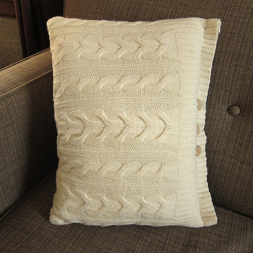 Pillow with cable knit sweater pillowcase in cream