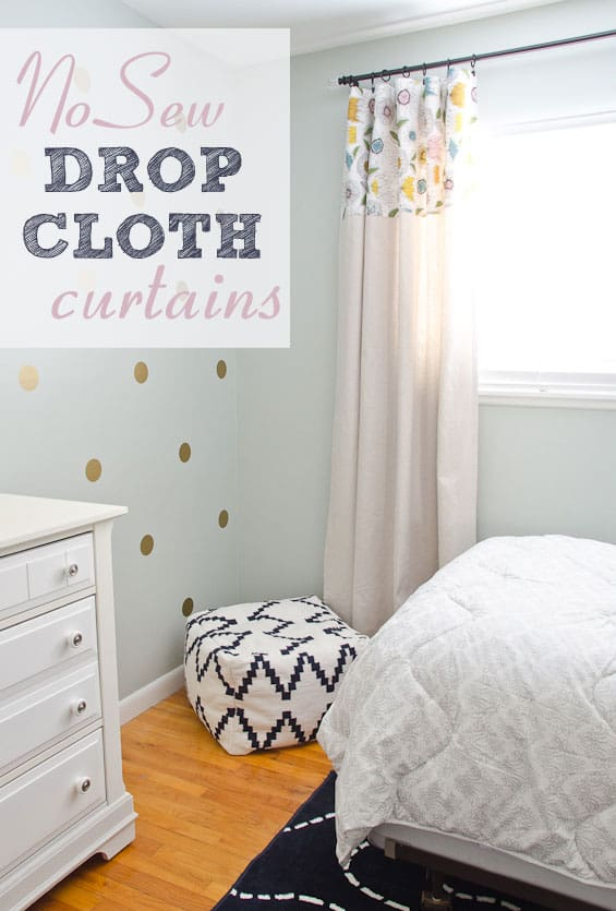 Bedroom with dropcloth curtain that has floral fabric accent on the top third