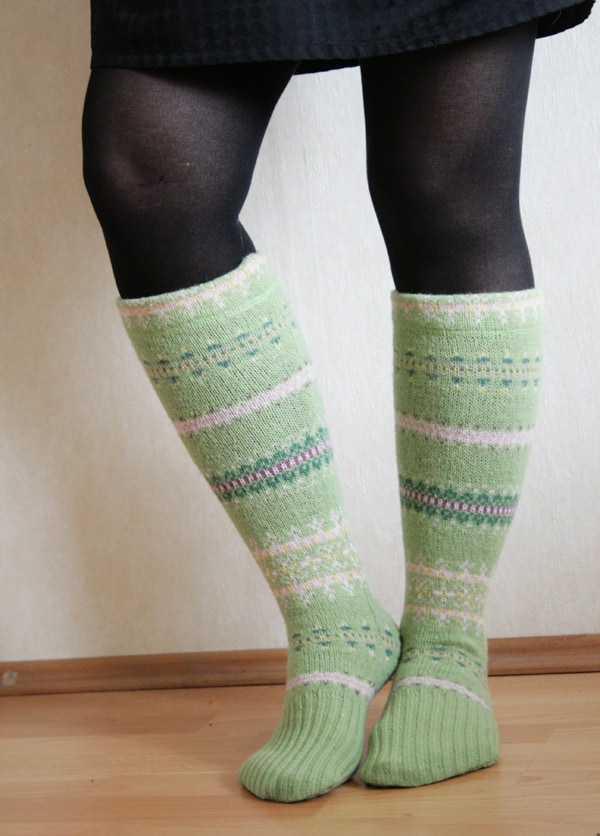 Woman wearing mint green and white fair isle knee socks