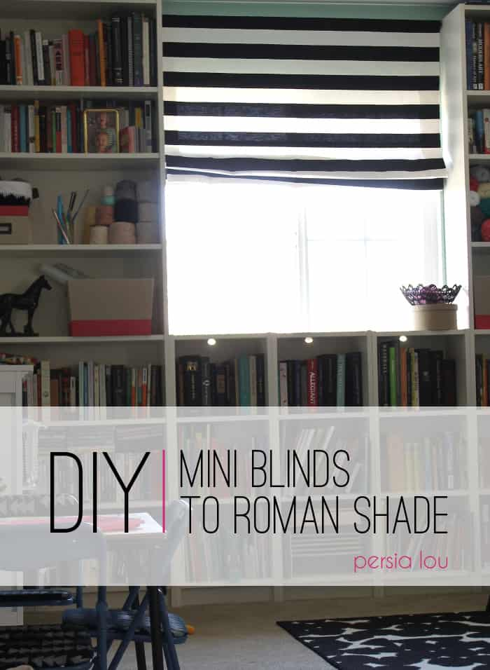 black and white striped roman shades in a window