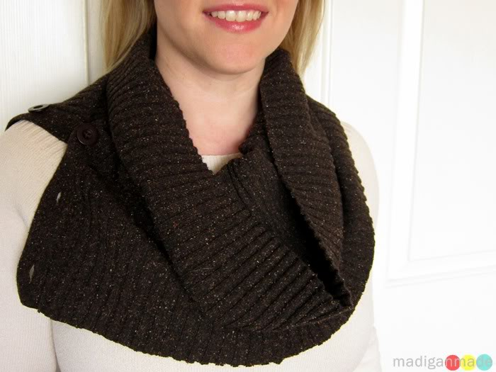 Woman from chin down wearing a brown button up neck warmer