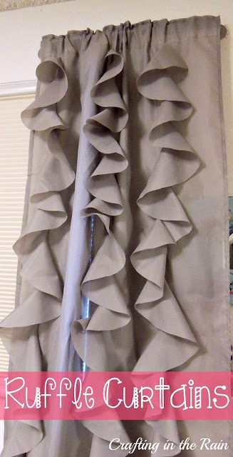 Gray curtains with vertical ruffles on them