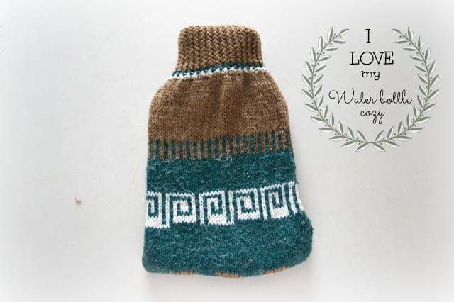 Hot water bottel cozy made from a teal and brown sweater