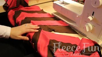 PErson sewing a chevron fleece scarf
