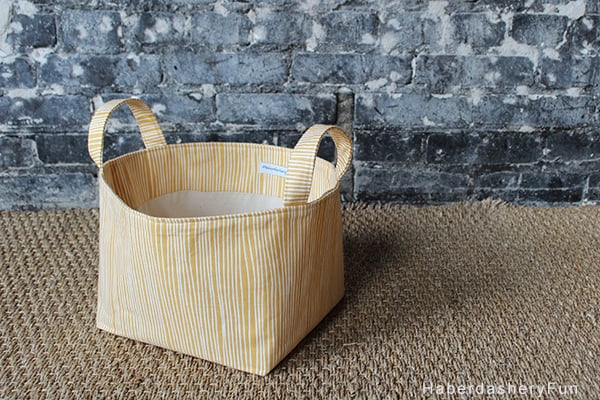 Fabric Ribbon Diaper Caddy Basket | littleredwindow.com