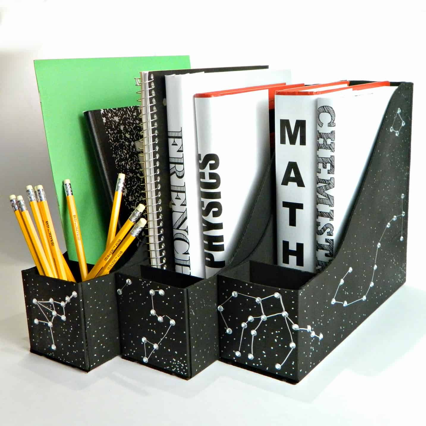 Black magazine holders with star constellation patterns on it