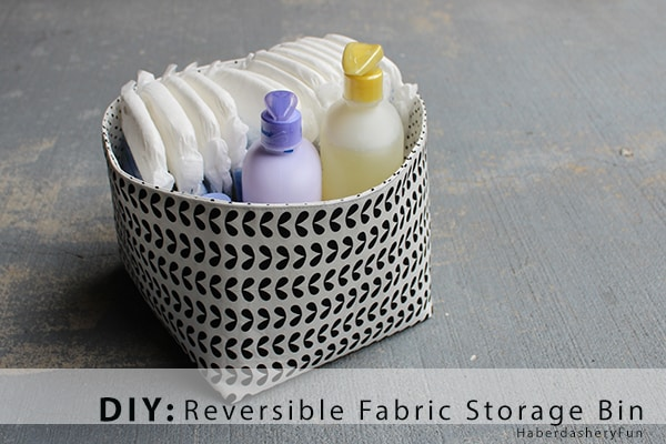 Black and white fabric bin filled with diapers and soap