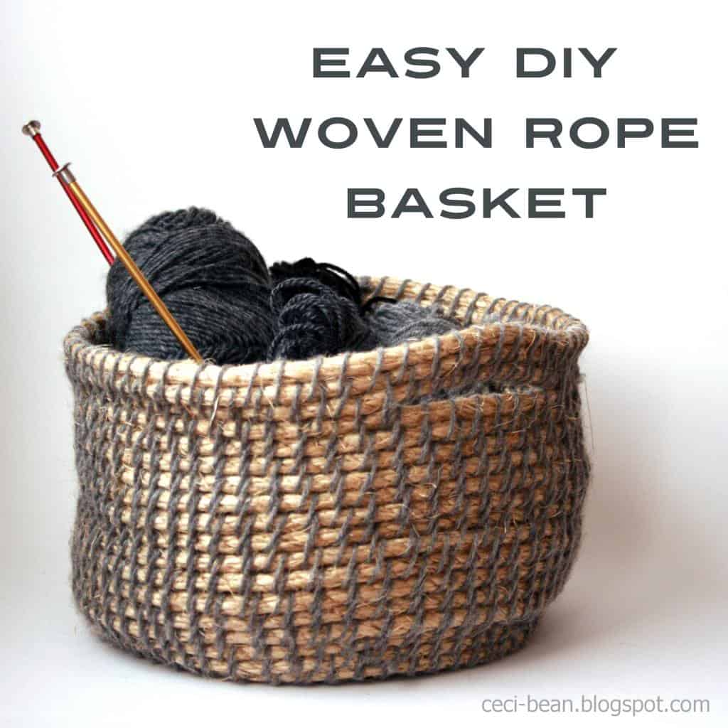 Woven rope basket with balls of black yarn and knitting needles inside