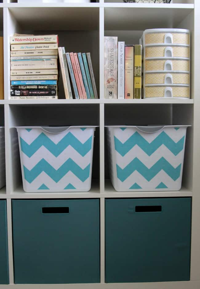 White bookcase with blue and white chevron bins