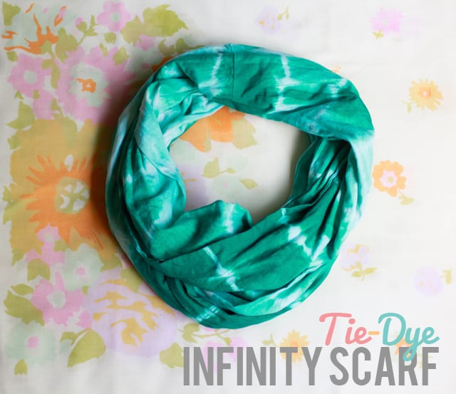 Green tie dyr infinity scarf on a floral background