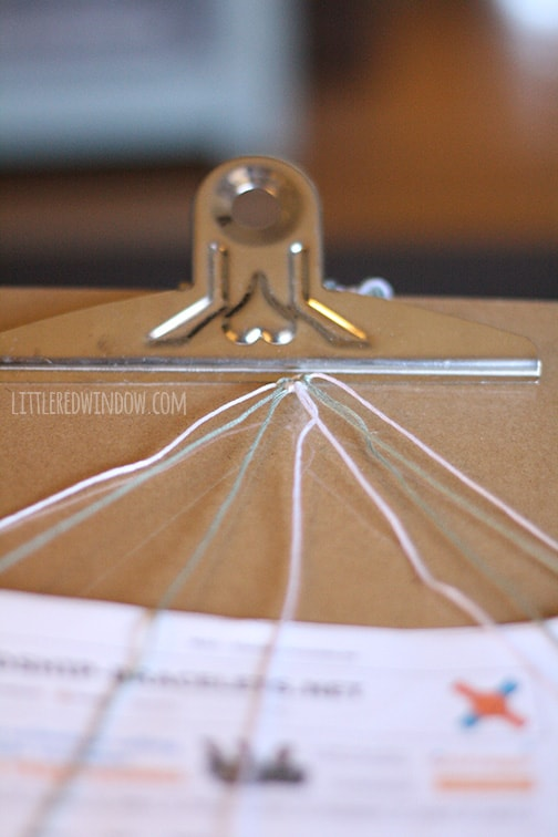 embroidery strings attached to a clipboard clip
