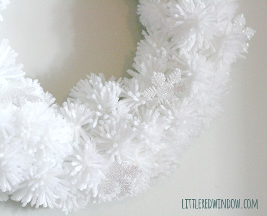 DIY Fluffy Snowflake Pom Pom Wreath | littleredwindow.com  |Make a soft fluffy and easy snowflake wreath from pom poms!