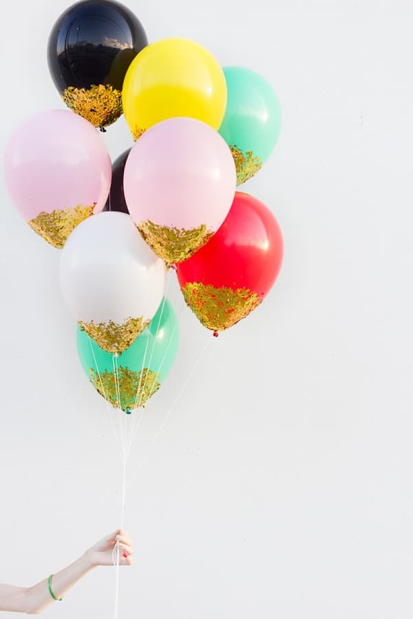 bunch of balloon dipped in gold glitter