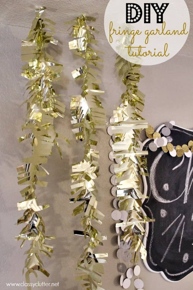 gold fringe garland hanging on a wall