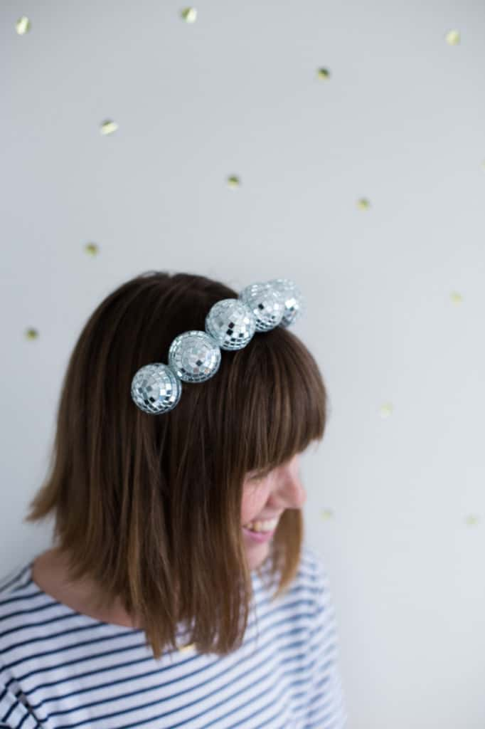 Woman wearing heaband made of small disco balls