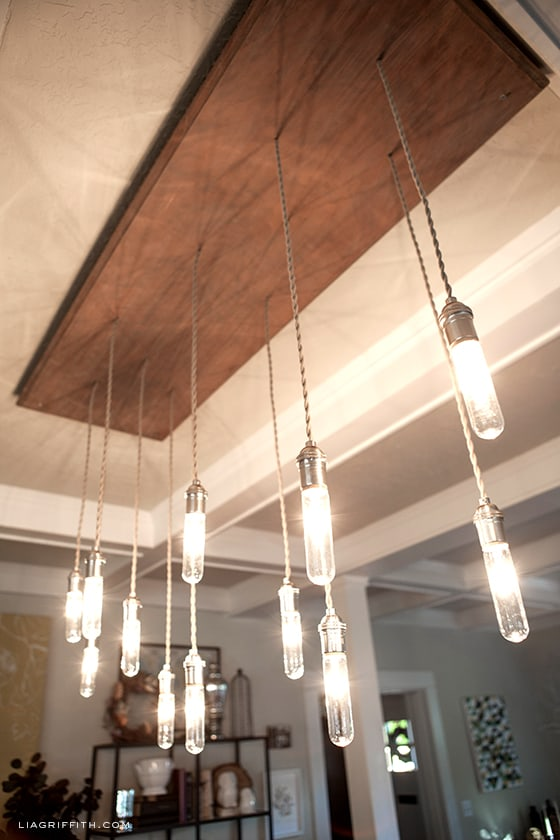Wood rectangle on the ceiling with lots of small hangling lightbulbs hanging down