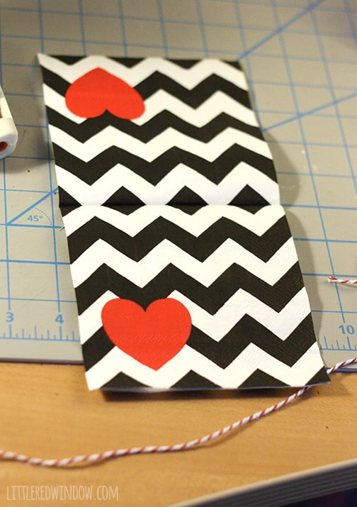 Black and white chevron napkin with a red heart in one corner and a piece of baker's twine