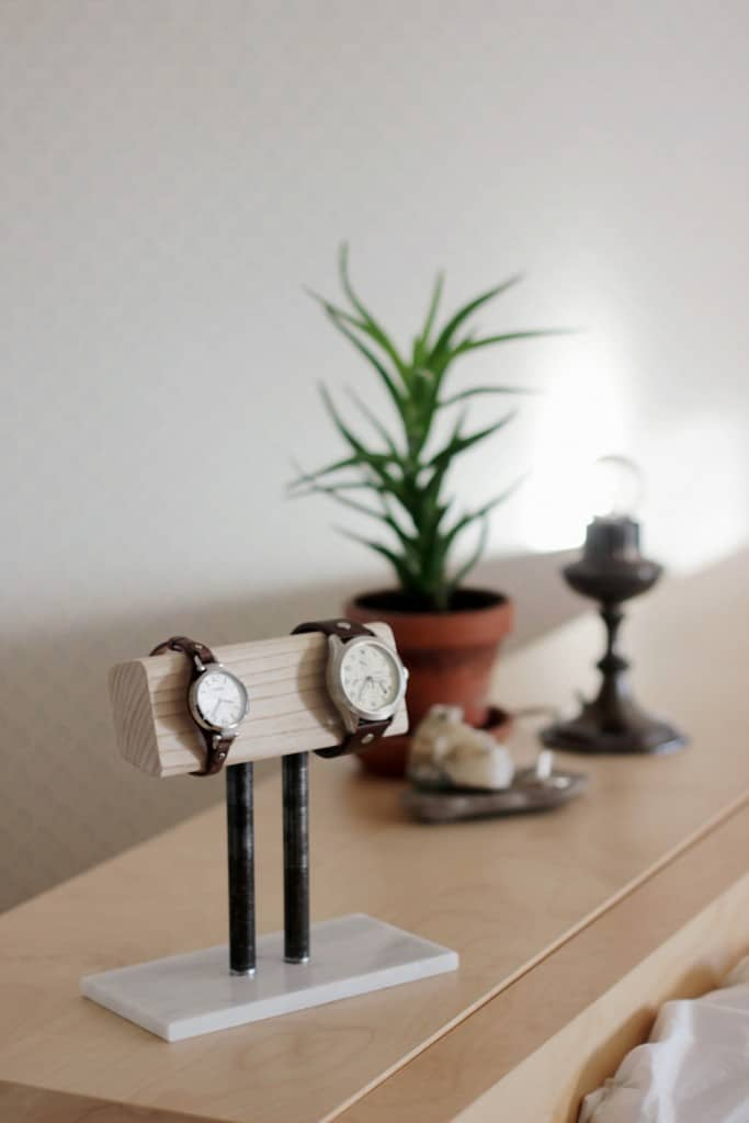 Wood and metal watch holder stand on a dresser top
