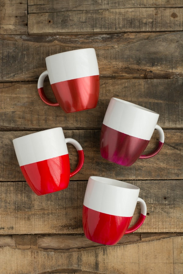 4 white coffee mugs with the bottom halves dippes in shades of red