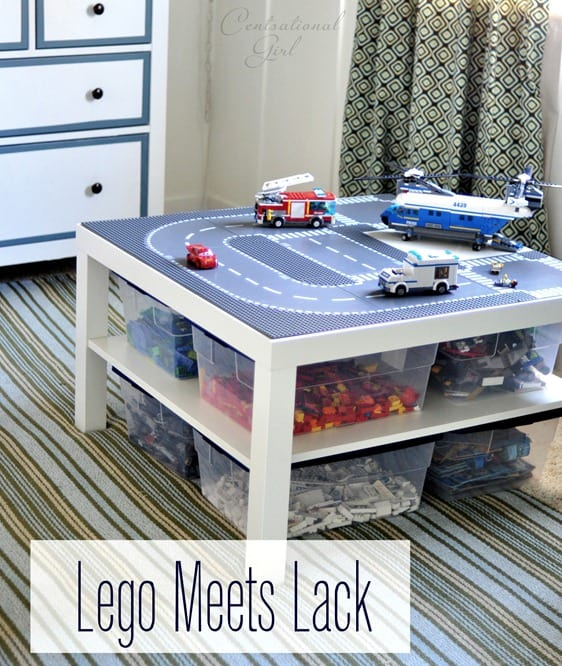 white IKEA table with a lego road top and leg vehicles on it