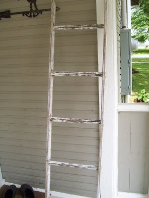 ladder made of distressed white wood