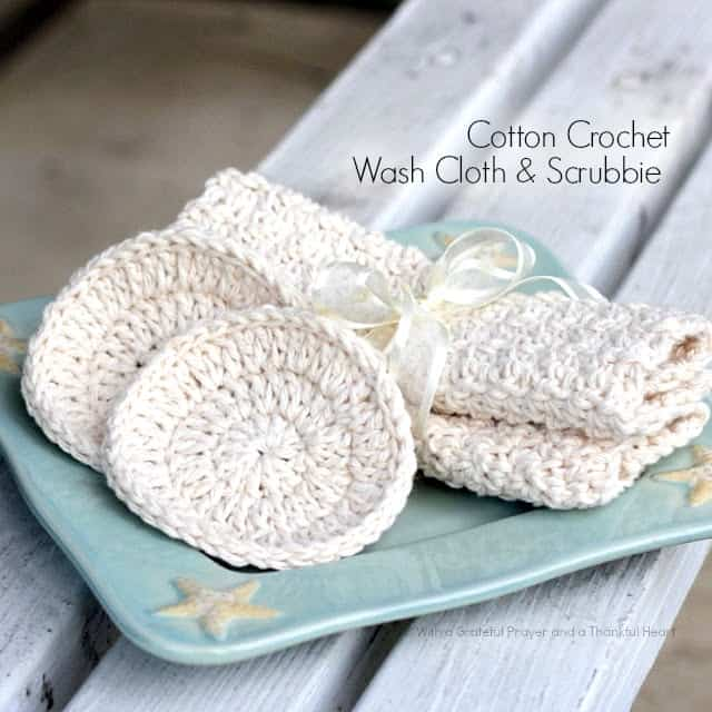 white cotton crocher washcloth and scrubbie on blue plate