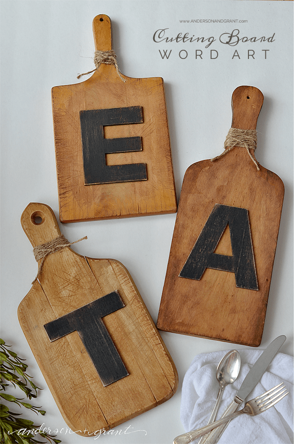 three wood cutting boards with the letters E A T